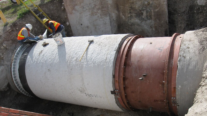 Image of pipes being built underground.
