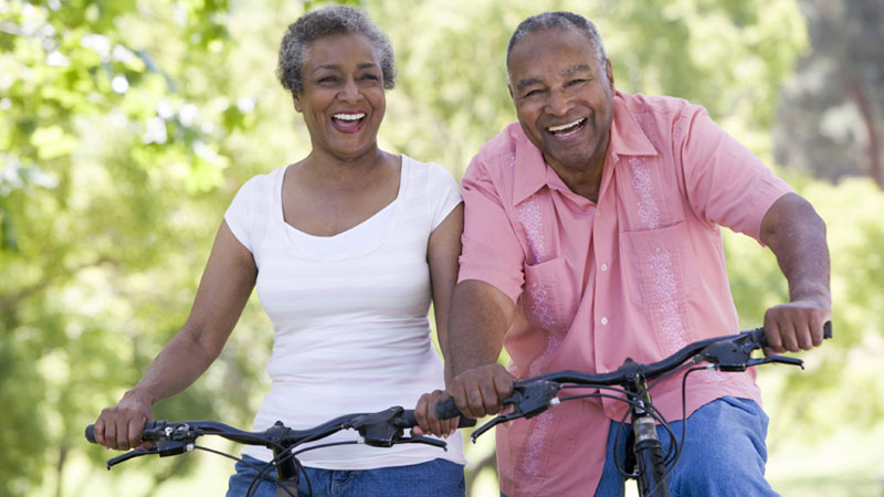 older couple riding their bikes