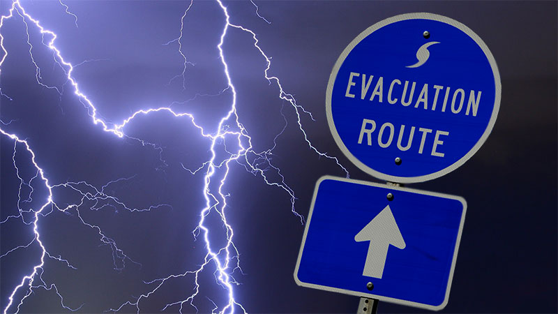 EVACUATION ROUTE street sign with a stormy background